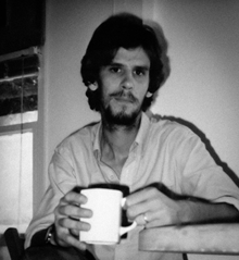 Spence Munsinger in 1987 at table with coffee mug, in Sherman Oaks, CA